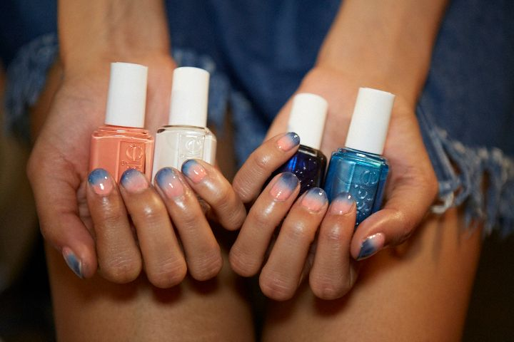"""Color: WHETHER IT'S COLOR GRADATION FROM FINGER TO FINGER OR ON EACH NAIL, OR TWO ACCENT NAILS INSTEAD OF ONE, PLAYING WITH COLOR CAN CREATE A UNIQUE LOOK. Michelle Saunders for Essie created this """"lucite sunset"""" design at Rebecca Minkoff's show at NYFW."""