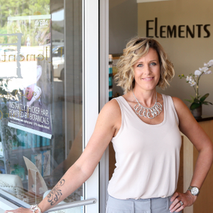 Jessica Greene welcomes guests into her Elements Salon in Fernandina Beach, Florida, as she...