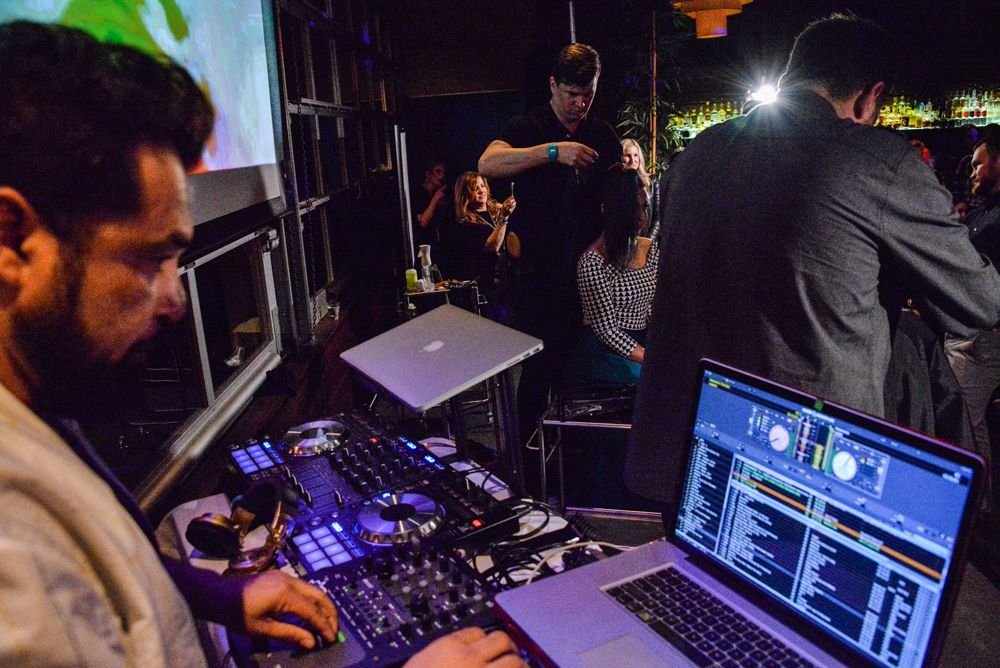 A live DJ keeps the energy high at an Elevate event.