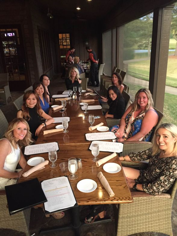Amanda Hair and her Elite Eight enjoy a relaxing dinner at this year's retreat.