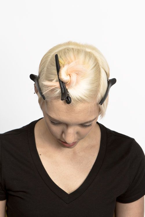 2. Split the back section in half. Start with the back left panel. Outline the section. Take diagonal partings starting below the crown and apply peach formula, scalp to ends. Comb through for maximum saturation. Finish application through side of face.
