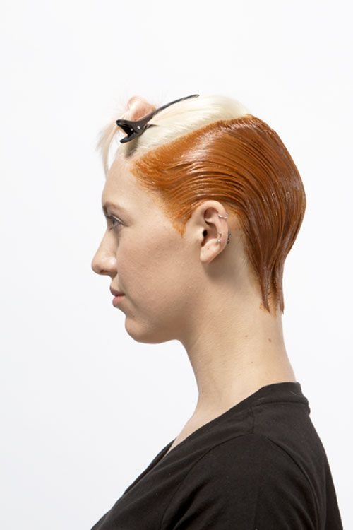 3. Move to the front/ fringe area and apply the strawberry formula from hairline to zigzag parting and onto a foil. Cover with foil.
