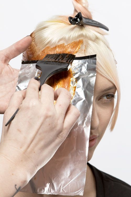4. Create a large C-shaped parting at the fringe. Take 1/8-inch sections and apply mellow yellow formula onto foil from base to ends. Continue through the entire section.