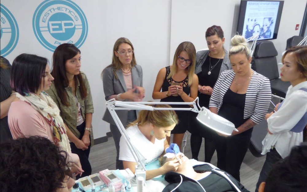 Lindsey Rae Joslyn Rohner teaching a class of lash artists. <strong><br /></strong>