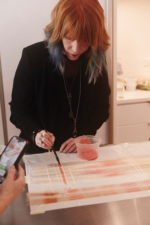 <strong>EXTENSION PREP:</strong> Nanci Lee created several customized extensions for this look using Matrix Color Sync Watercolors, equal parts Coral Peach and Quartz Pink, applied on top of Matrix Clear with a soft brushing technique.