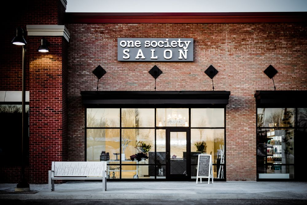 The exterior of One Society Salon.