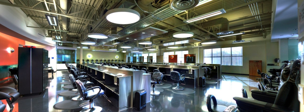 Owner credits the networking and sharing gained from her first AACS convention in 2009 with shaping her vision and design execution for the modern, high-end facility. Sleek, stainless steel, custom form meets flexible function. Station mirrors raise and lower at touch of a button, and even the stage converts easily and electronically into different formats.