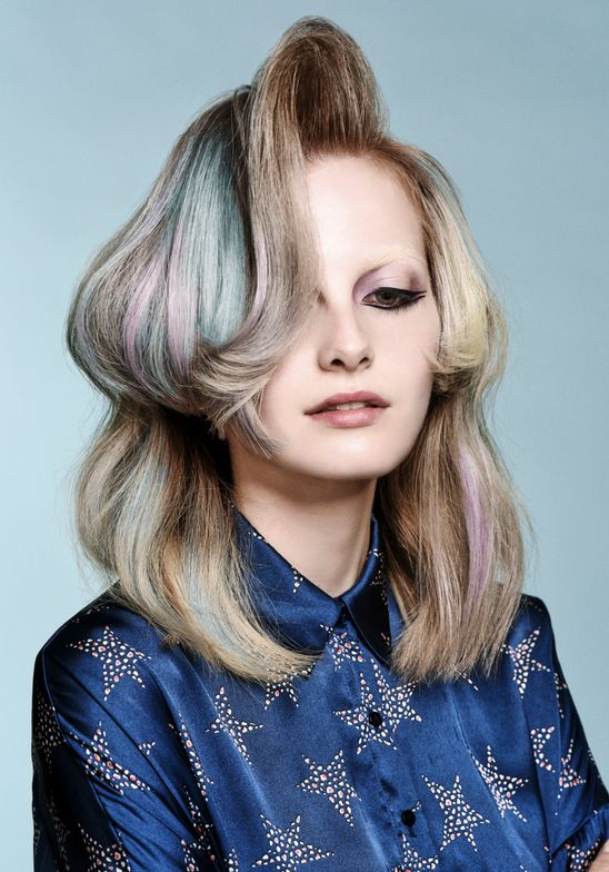 """Most of our clients aspire for volume, says Reid. For the hair cut we created strong lines which enhances the thickness in the style. We also opted for marbled ash gray, silver blue and soft violet in the color."""