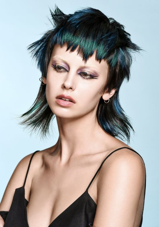 <p>To complement the strong, choppy bang and texture in the hair cut created by stylist Richard Mannah, Reid worked with blue and green to create a strong marbled effect that really embraces multi-dimensional color.</p>
