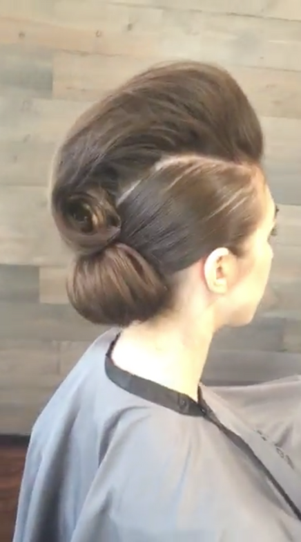 <strong>Step 8:</strong> Create a curl just above the chignon and secure. Finishing the look using All Around Color Protect Working Hairspray for touchable hold and extreme shine.