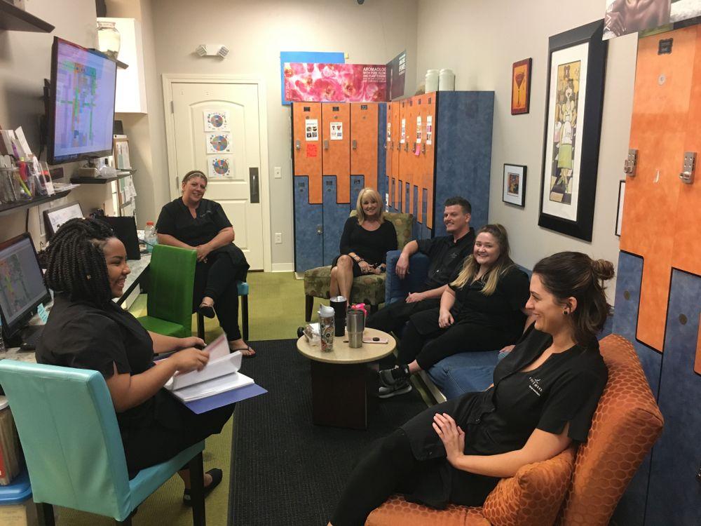 Team members from Five Senses Spa, Salon and Barbershop in their breakroom.