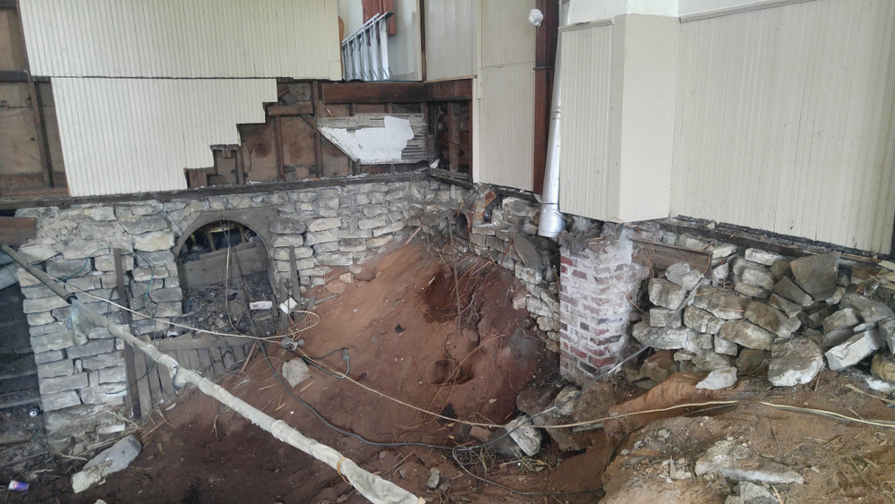 Because the foundation was crumbling, the building had to be lifted, stabilized and reinforced with concrete walls.