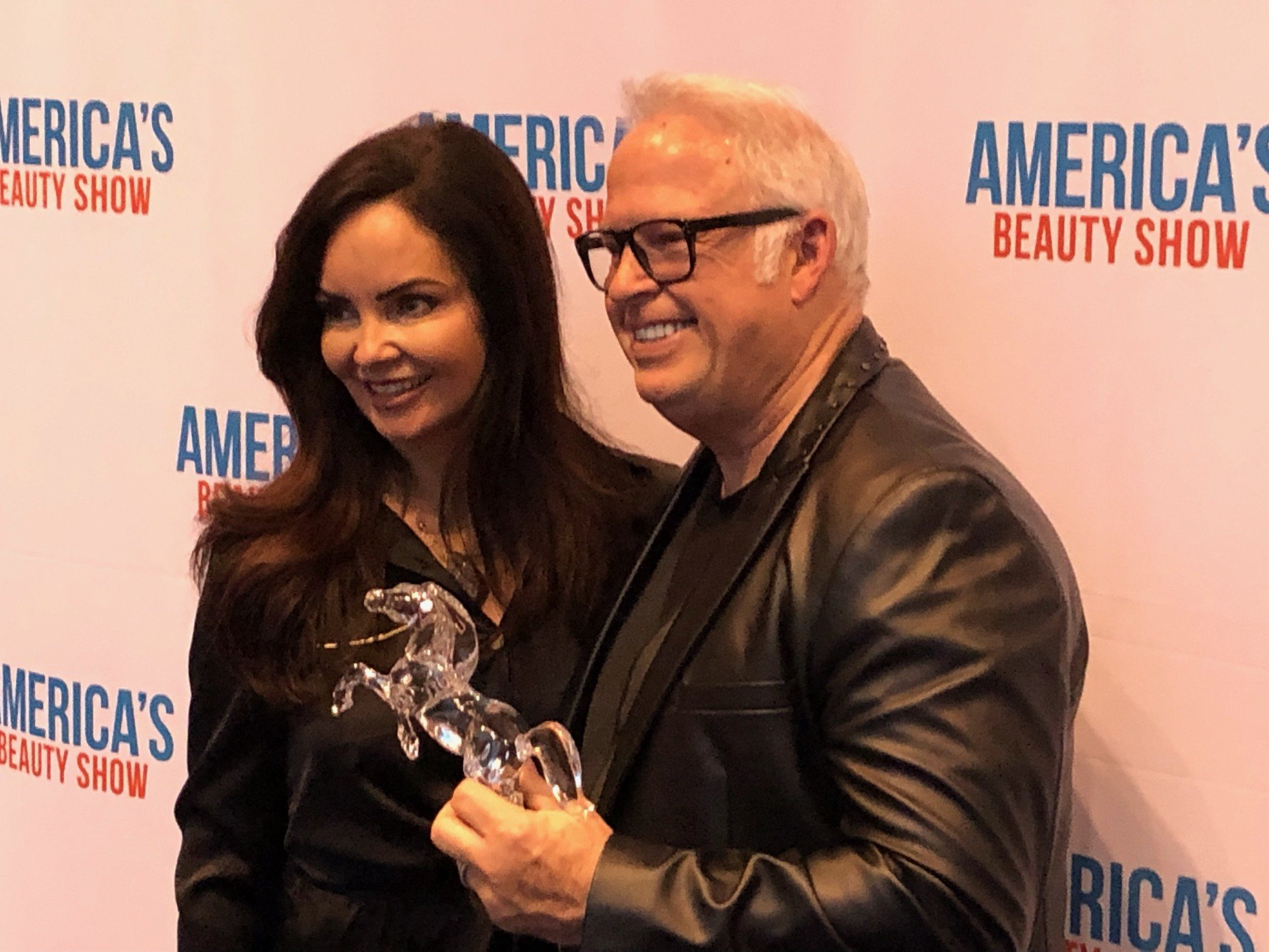 Frank Gambuzza, pictured with his wife Belinda Gambuzza, accepts the 2019 Jerry Gordon Salon Business Leadership Award at the Cosmetologists Chicago President's VIP Reception held during America's Beauty Show.