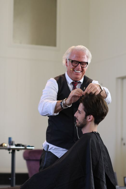<p>Frank Gambuzza offers grooming tips as he prepares his male model.</p>
