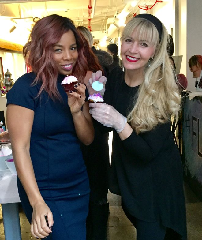 """Kiyah Wright and Maggie Mulhern decorate """"Flare Me"""" cupcakes at the launch of line at the Wella Studios in NYC."""