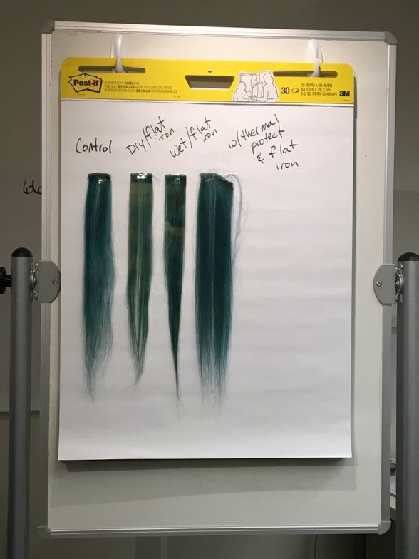 Wefts of colored hair show damage from various treatments.