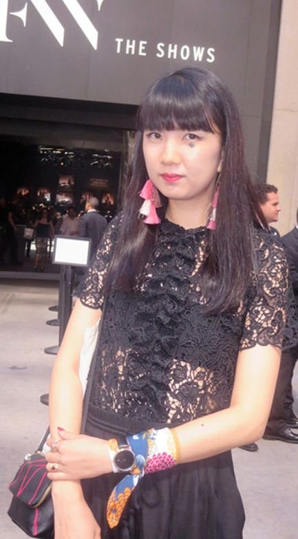 Zara black lace top with H&amp;M pink/white tassel earrings, watch over scarf, all on target, worn by Mitsuho, who is Japanese. (The great heart-shaped mole under her eye is her own)<br />Photo: Helen Oppenheim