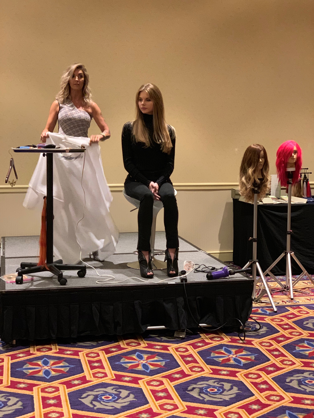 NAHA 2018 Hairstylist of the Year and Great Lengths USA Executive Artistic Director Danielle Keasling begins her tape-in tutorial.