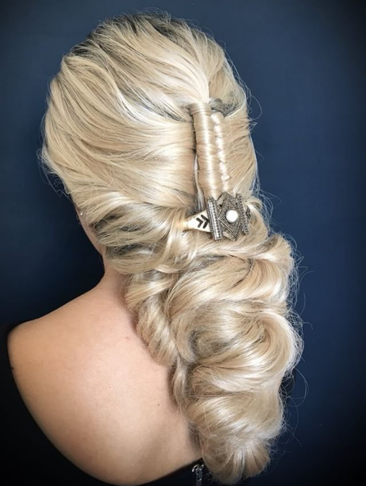"""This look gets me with the detailing,"" says Artist Collective member and judge Alexa Grace Chwarzynski. ""The zipper braid down the center catches my eye right away. It's perfect for that person who still wants something secure and pinned but is down!"""