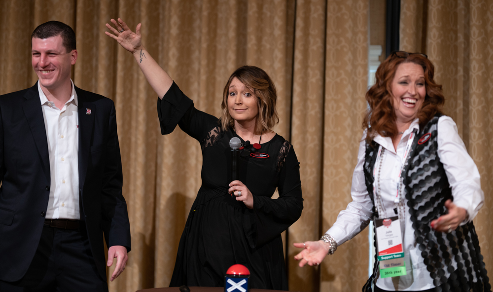 <strong>SportClips team members love to have fun and what's more fun than a game show? Amanda Friendshuh (center) released her inner game show host with contestants Edward Logan and Julie Vargas at the company's 2019 Huddle in Las Vegas.</strong>