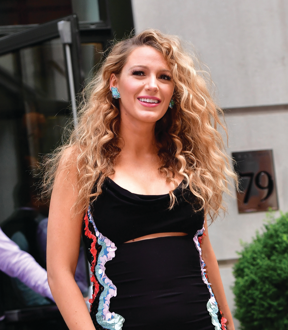 During the presstour for The Shallows, BlakeLively's stylist Rod Ortega useda curling iron to enhance her natural texture into high-volumeringlets.