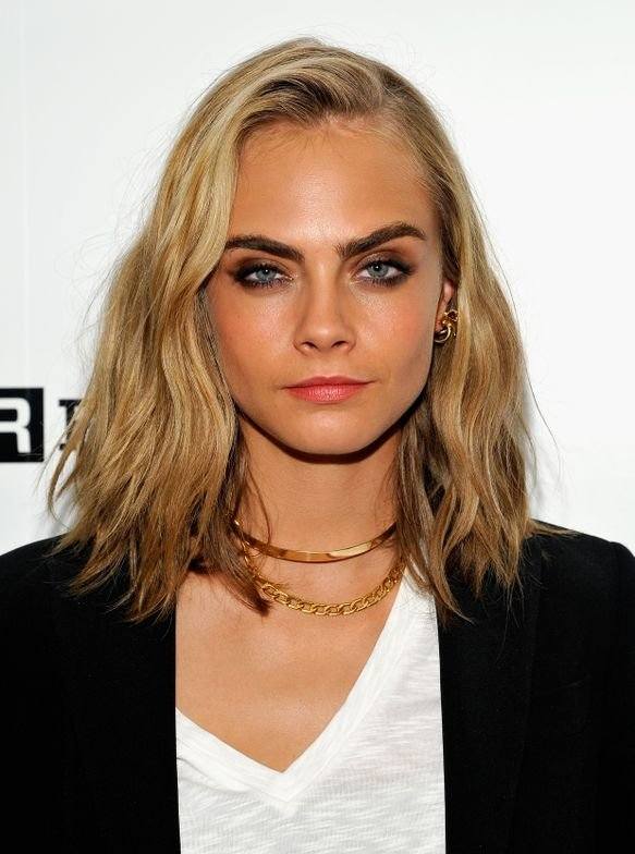 "To recreate Suicide Squad star Cara Delevingne's look, Joel Torres, TIGI creative director, would use Catwalk by TIGI Texturizing Salt Spray on wet hair and blowdry while twisting a round brush to create movement. ""After hair is dry, I would use a 1-inch wand and Catwalk by TIGI Session Series Work It Hairspray and take big sections horizontally to create a soft wave in different directions,"" Torres says. To finish, apply Bed Head by TIGI Joyride Texturizing Powder Balm and finger-comb hair to define the look."