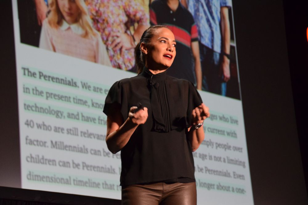 <p>Blogger Gina Pell helps attendees redefine themselves as Perennials.</p>