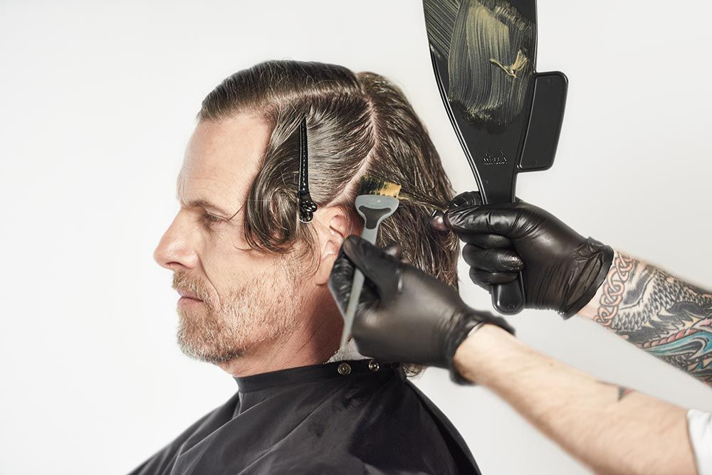 """<strong>STEP 3:</strong> On the sides, take slightly diagonal sections and lightly paint the formula roots to ends until you reach the hairline.<br />TIP: For a natural look on male clients, omit the last 1/8"""" at the front hairline."""