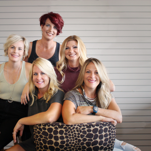 Salon Rootz owners (seated) Jennifer Tryon and Sheila Barco are surrounded by their marketing...