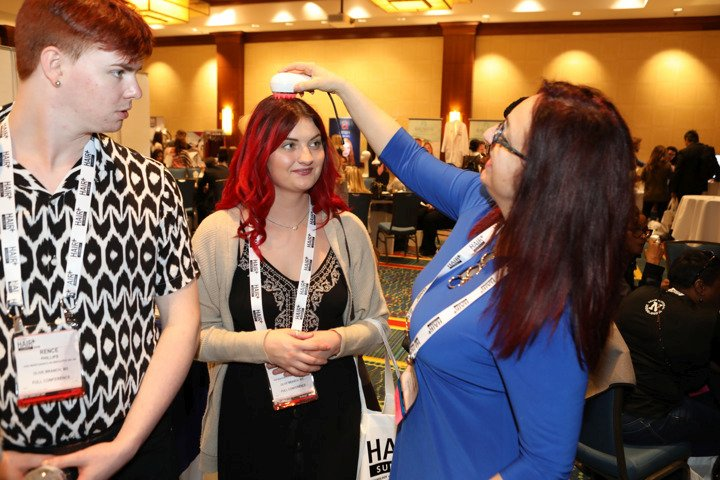 On the show floor, HAIR+ attendees get to sample the Magic Scalp.