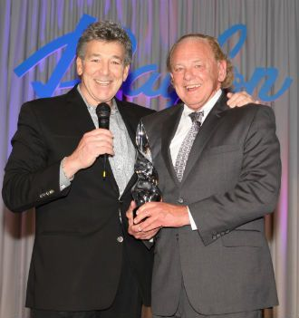 RAylon CEO Howard Hafetz presents the 2013 Art of Business Award to Dr. Lew Losoncy.