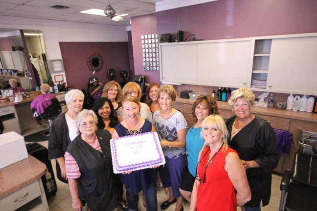 The team from Hair Anatomy celebrate their win of Salon Today's Total Salon Makeover competition with a cake.