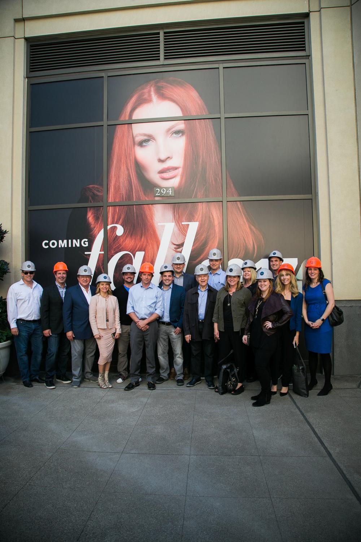 <p>The Tour de ISBN participants don hard hats before touring Gene Juarez's newest flagship salon, currently under construction.</p>