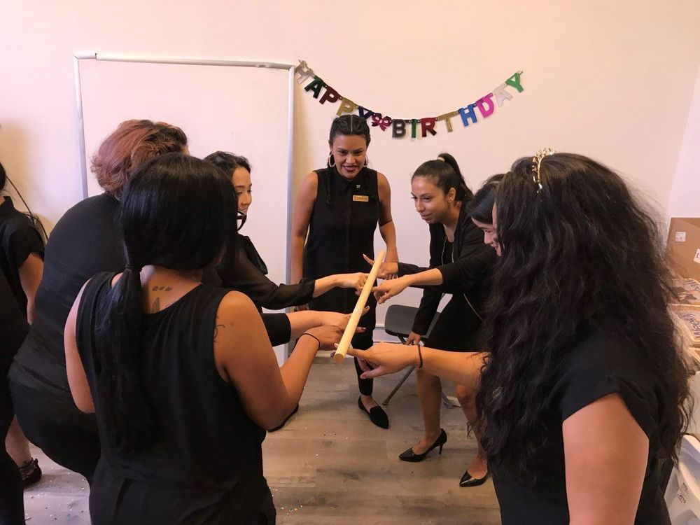 By playing Helium Stick, staff members at Integrity Lash learn to work together as a team.