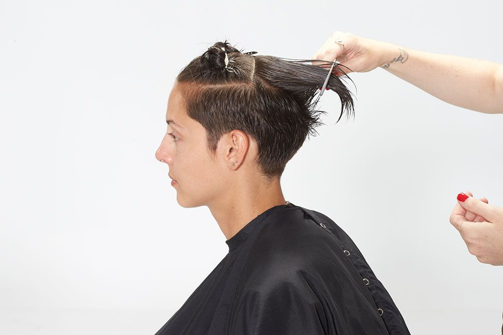 4. Now take the hair from along the top. Direct back, elevate and clipper over comb, leaving slightly disconnected.
