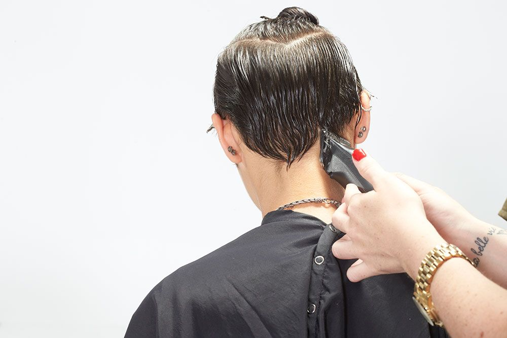 8. Return to the back hairline. Define the line, creating a deep V at the nape.