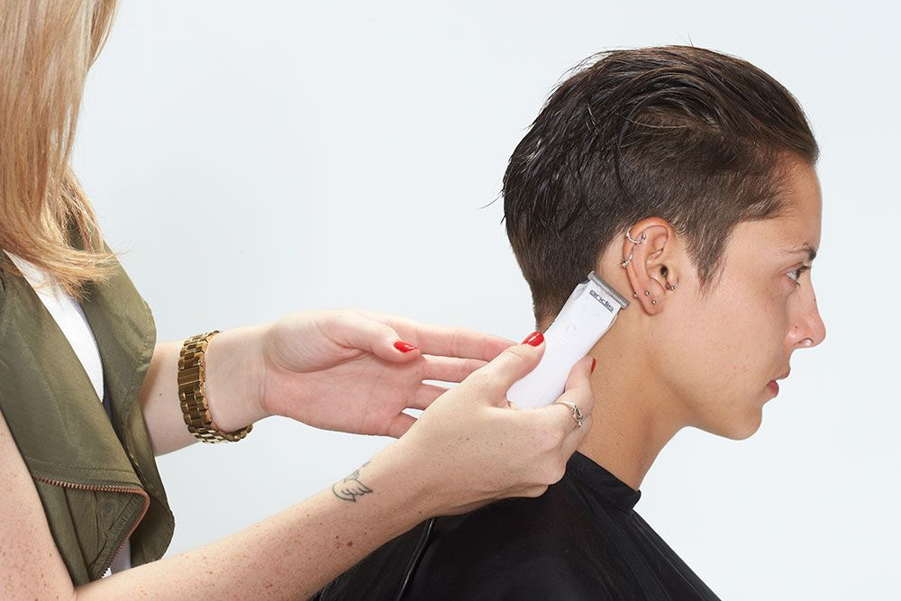 10. Clean up the line along the hairline with the Andis Charm trimmer.
