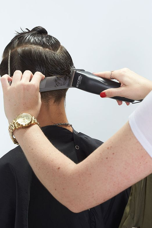 11. Using the Andis Excel Ultra, clipper over comb to blend occipital.