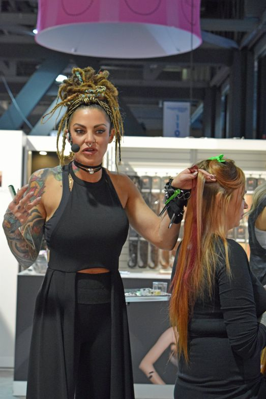Victoria Casciola, a three-time MODERN SALON cover artist, demos Hotheads extensions at their booth.