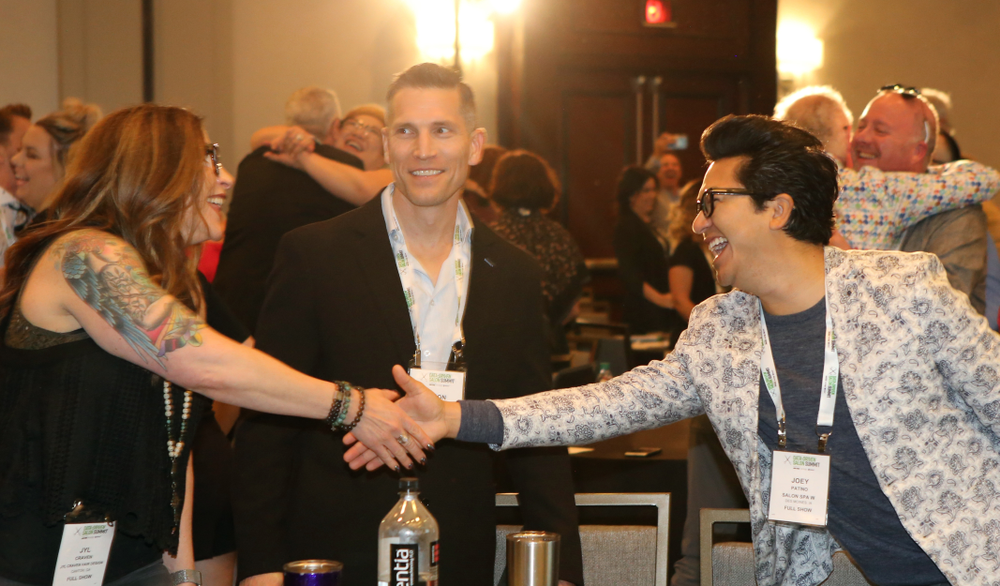 Attendees practice relationship building by practing the way they greet a trusted friend.