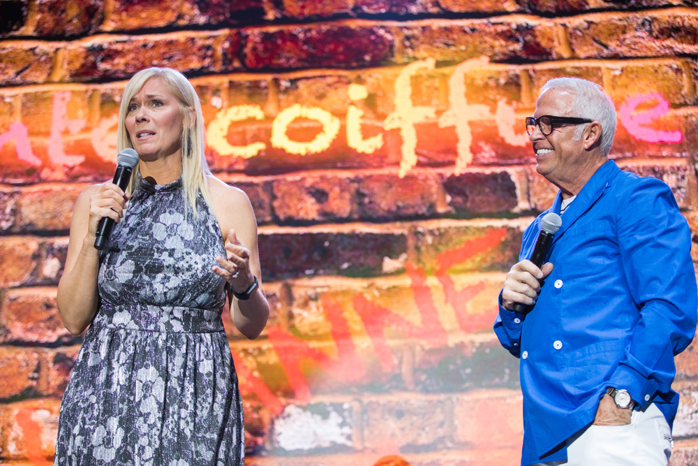 Leanne Marshall and Frank Gambuzza having fun on stage at the 2018 Intercoiffure Spring Atelier.