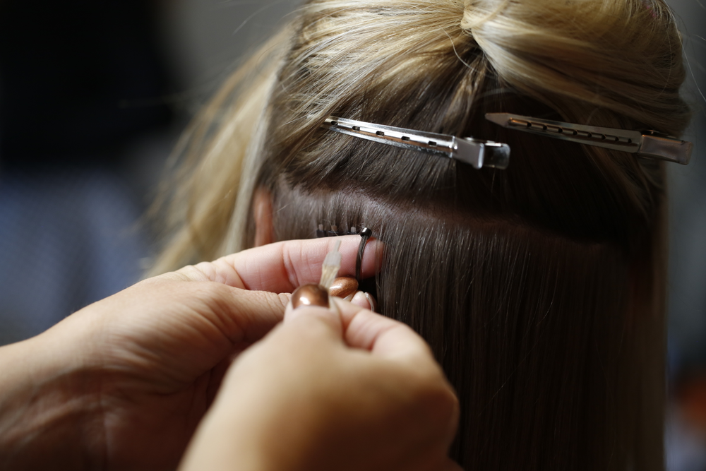 Applying Donna Bella's Flat-Tip Hair Extensions.