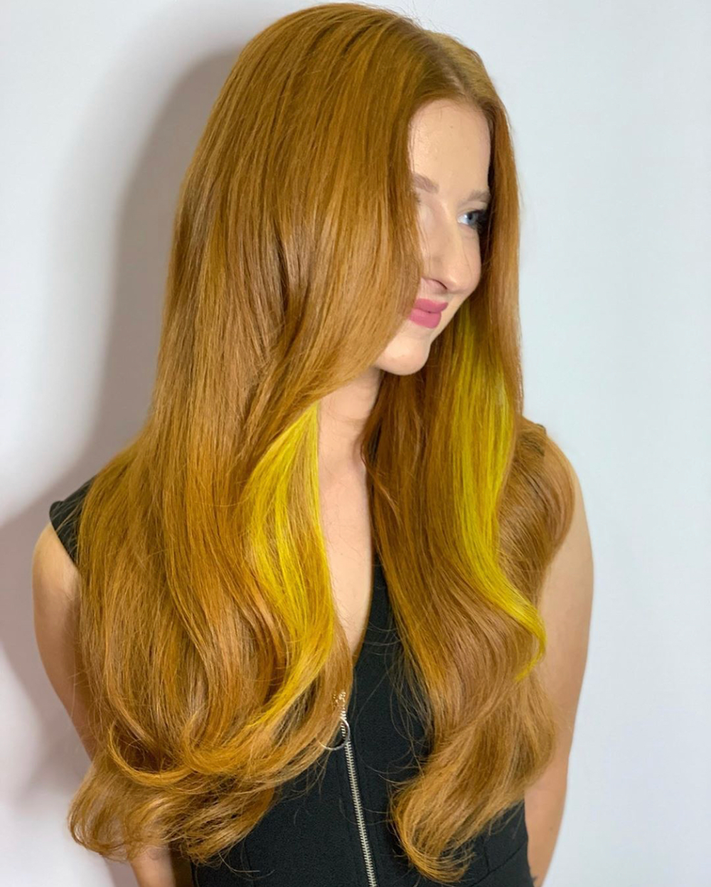 """""""The appropriate amount of natural contrast in your red extension installations will ensure the most seamless and natural outcome,"""" says Cinalli, an artist and educator for Hairtalk Hair Extensions. """"This transformation is a true ode to the power of color combination with your tape-in extension application!"""""""