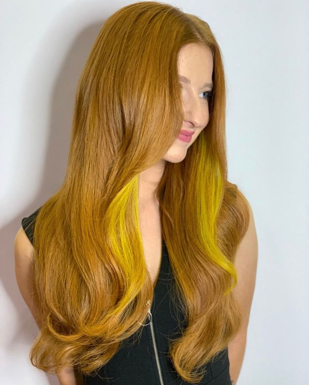 """The appropriate amount of natural contrast in your red extension installations will ensure the most seamless and natural outcome,"" says Cinalli, an artist and educator for Hairtalk Hair Extensions. ""This transformation is a true ode to the power of color combination with your tape-in extension application!"""