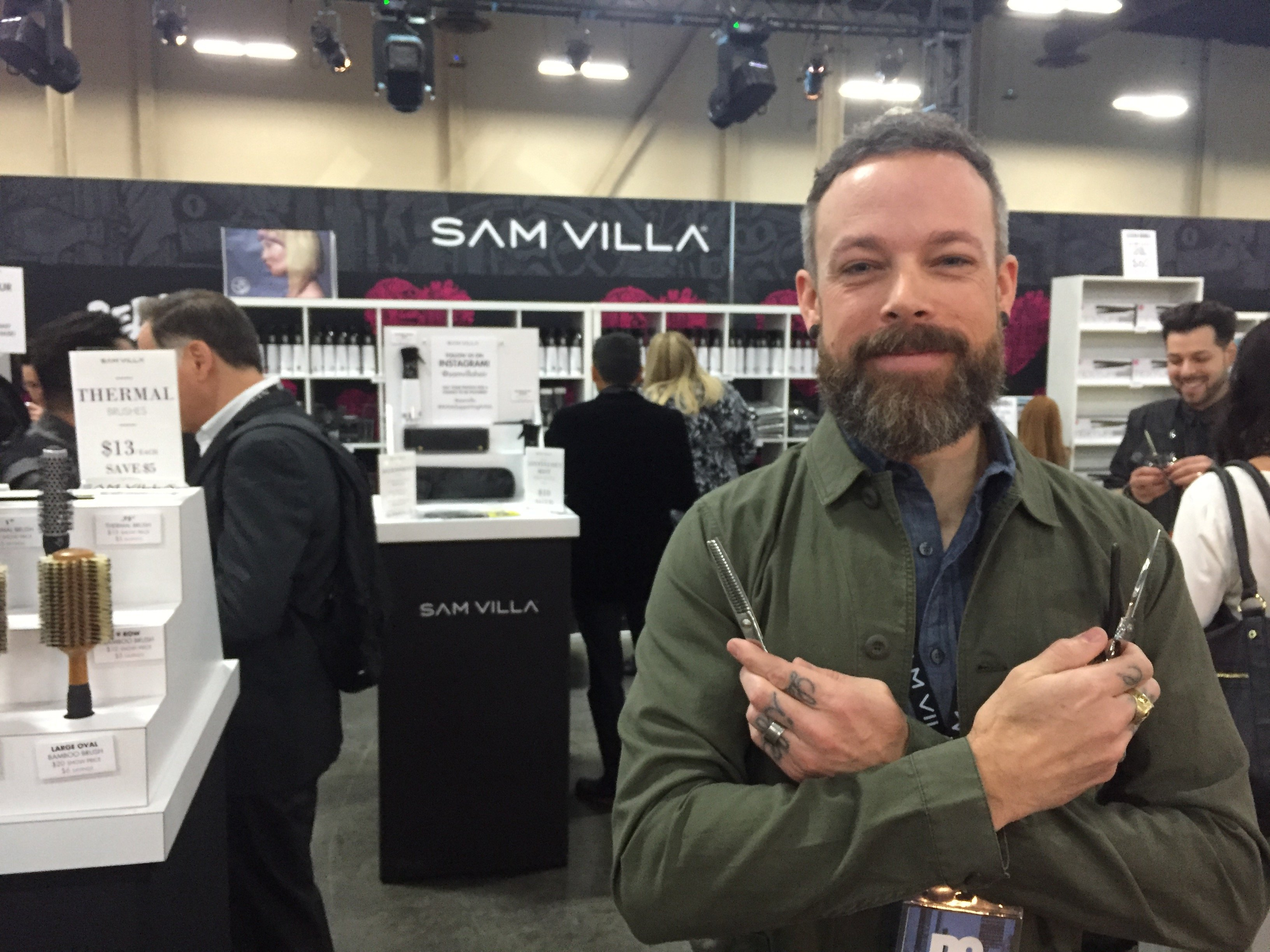 Andrew Carruthers at the Sam Villa booth in the Gallerie at Redken Symposium 2017.