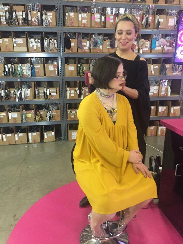 Mireya, Pink Pewter's founder and designer, curls Lindsey's hair.