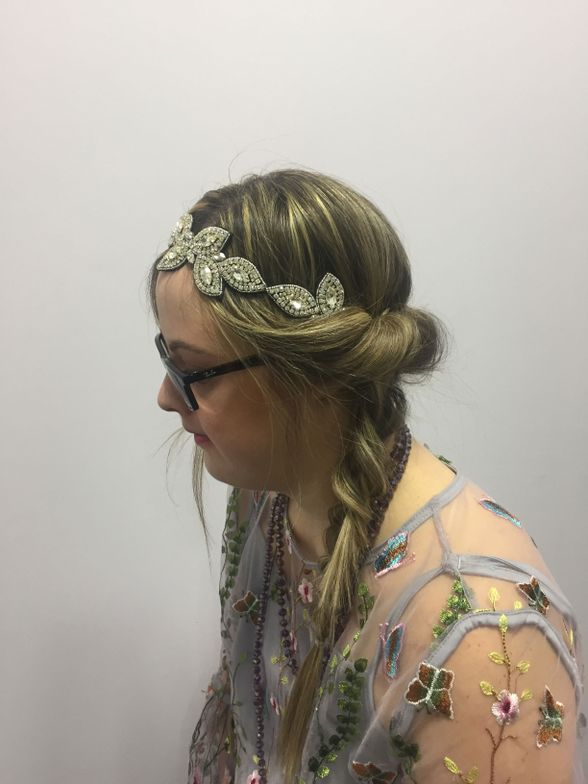 Julia chose her dress because it reminded her of her sister and grandmother. Her statement piece was a headband with intricate leaf designs. Her hair was tucked into a long braid to give a more effortless look.