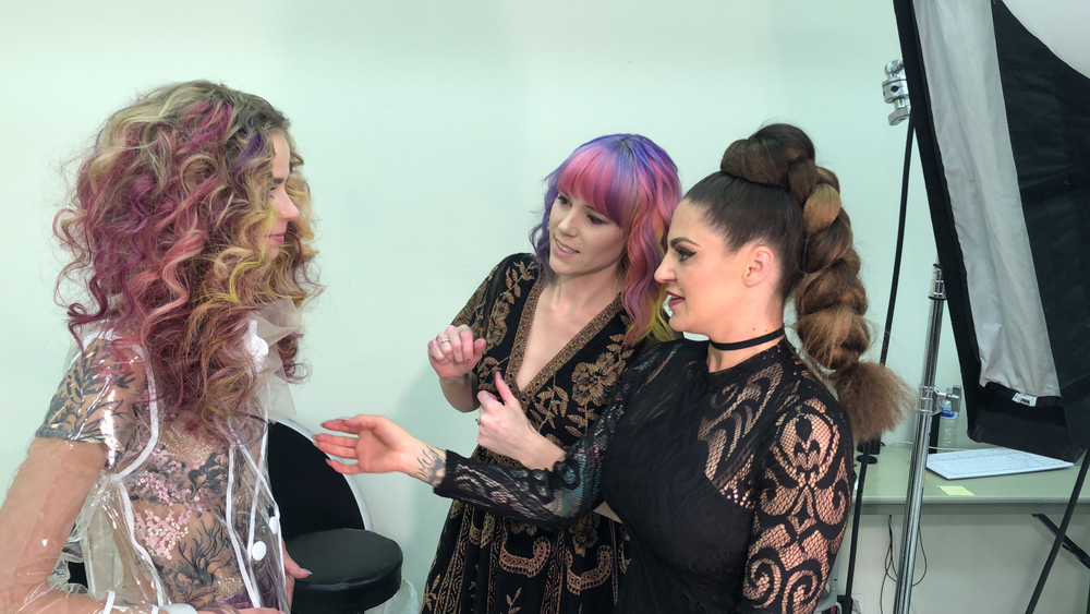 Sydney Ann Lopez and Vicki Casciola (Hairtalk Artistic Director) put the finishing touches on their model before heading to the set.