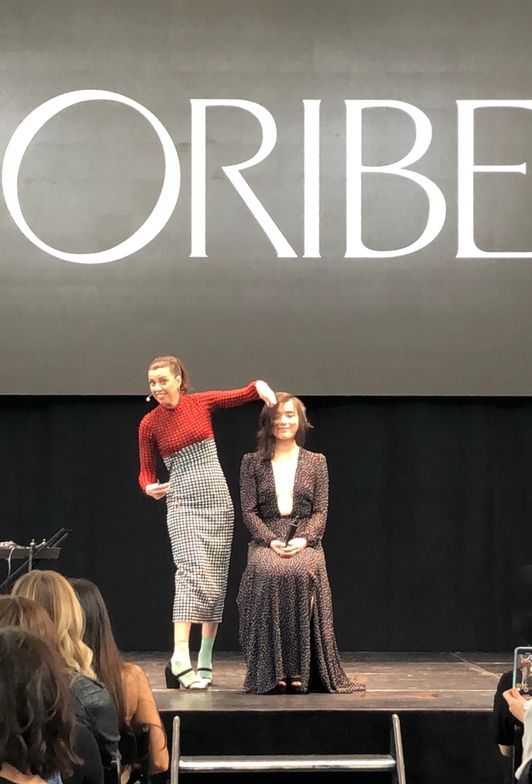 Coby Alcantar presents a new cutting method on stage at the Oribe Atelier.