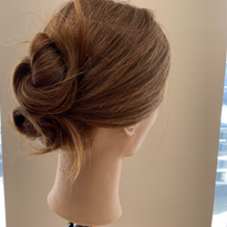 A double knotted chignon by ECRU New York's Amanda Jenkins.